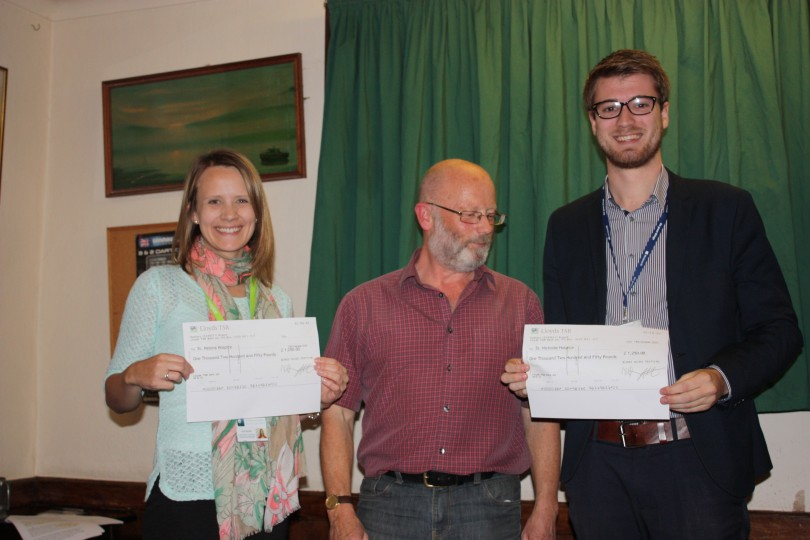 Ruth from St Helena Hospice and Jordan from St Nicholas Hospice receive their cheques from BMF Chairman, Peter Harries